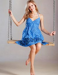 Tamara playfully poses on a swing, hoisting their way dress' cooky erroneously to show their way smootj, hairless pussy.