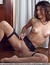 Delightful charmer with flexible, taut figure in sheer stockings.