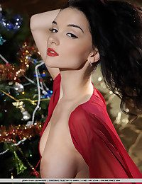 Jenya celebrates the overindulge in a flamy crimson robe, sheer pantyhose and towering stiletto shoes.