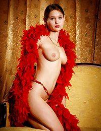 Puny Silvia redhead posing with the crimson boa